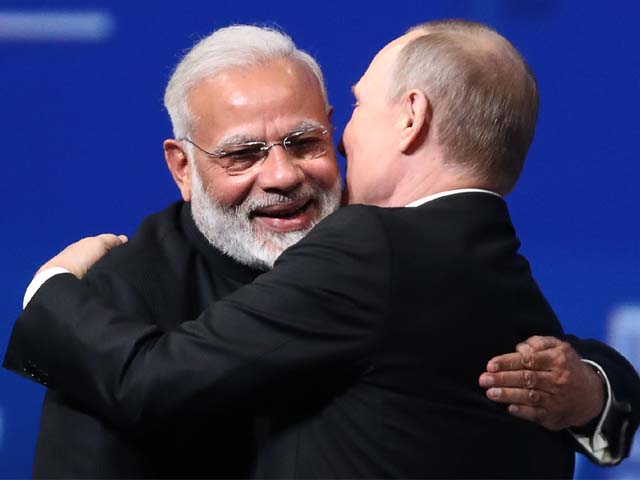 vladimir putin embraces narendra modi during a session at spief in 2017 photo afp
