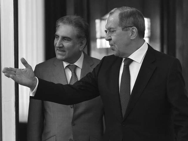 russian foreign minister sergey lavrov welcomes shah mehmood qureshi during their meeting in moscow russia photo afp
