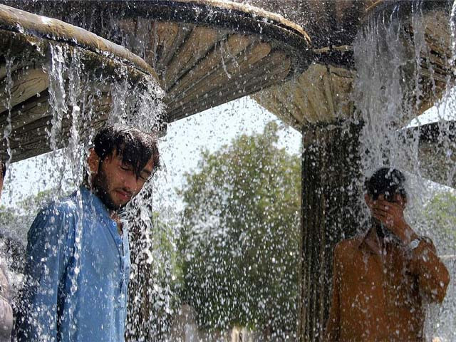 pakistani residents cool off during an hot summer day in karachi photo afp