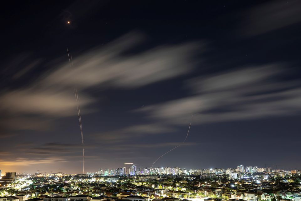 Streaks of light are seen as Israel's Iron Dome anti-missile system intercept rockets launched from the Gaza Strip towards Israel, as seen from Ashkelon, Israel May 18, 2021. PHOTO: REUTERS