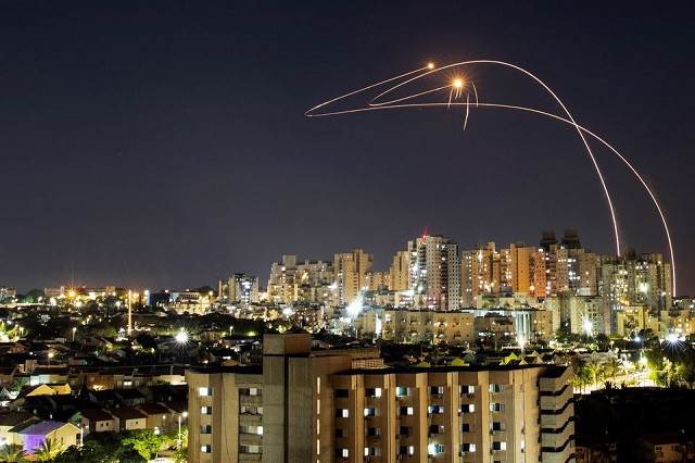 Streaks of light are seen as Israel's Iron Dome anti-missile system intercepts rockets launched from the Gaza Strip towards Israel, as seen from Ashkelon, Israel May 14, 2021. PHOTO: REUTERS