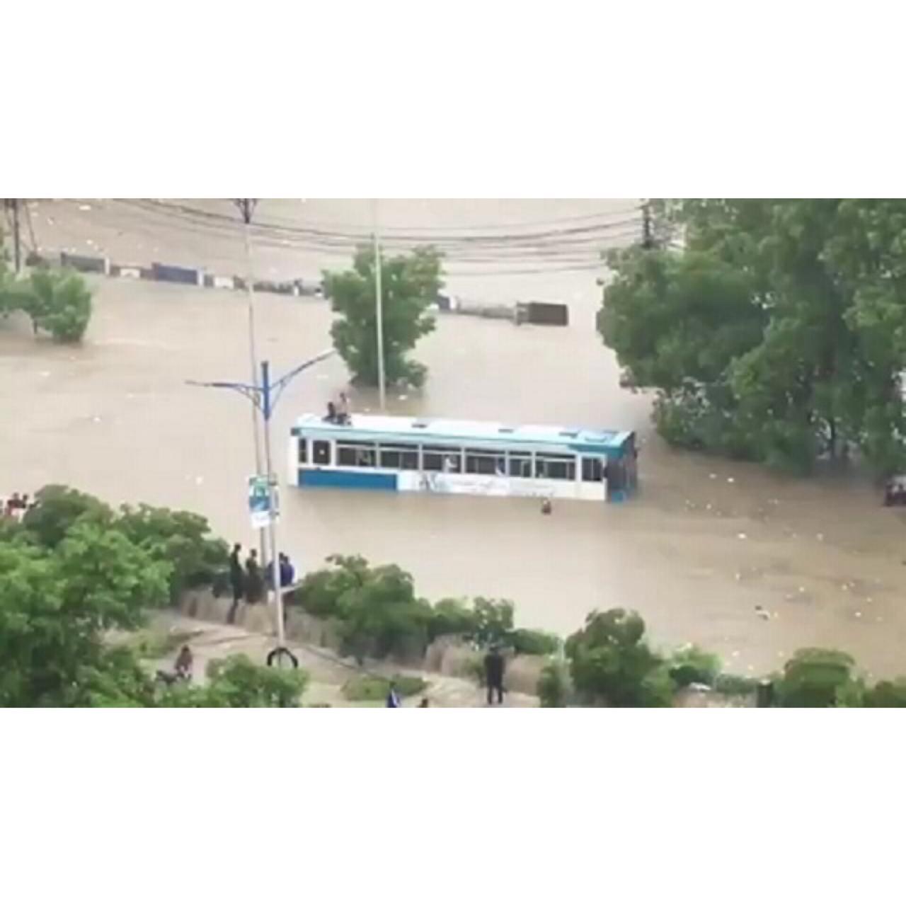 a bus carrying dow university staffers stuck in rainwater at nursery sharea faisal photo express file