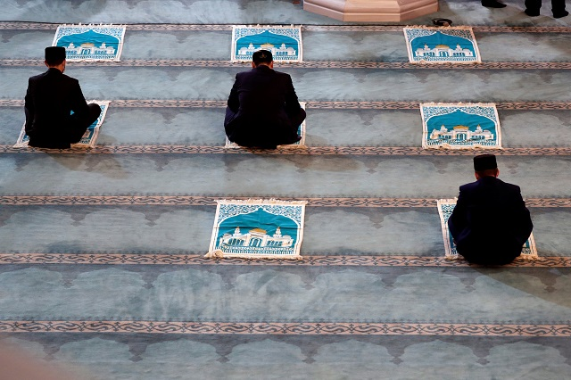 Clergymen get ready for a prayer marking the Muslim festival of Eidul Azha, while maintaining social distance amid the coronavirus disease (COVID-19) outbreak, in Moscow's grand mosque in Russia July 31, 2020. PHOTO: REUTERS