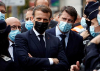 french president emmanuel macron and nice mayor christian estrosi right meet police officers after a knife attack at notre dame church in nice southern france thursday oct 29 2020 image credit ap