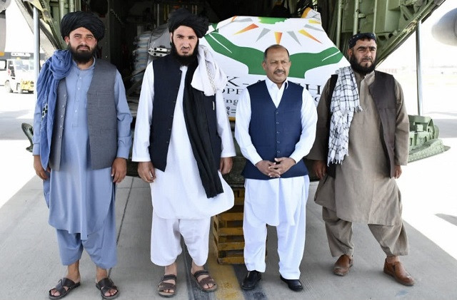 Ambassador Mansoor Ahmad Khan pictured at the delivery of the goods at the Hamid Karzai International Airport. PHOTO: APP