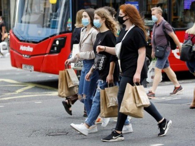 shoppers wear face masks on oxford street in london after face coverings became mandatory in shops and supermarkets in britain photo afp