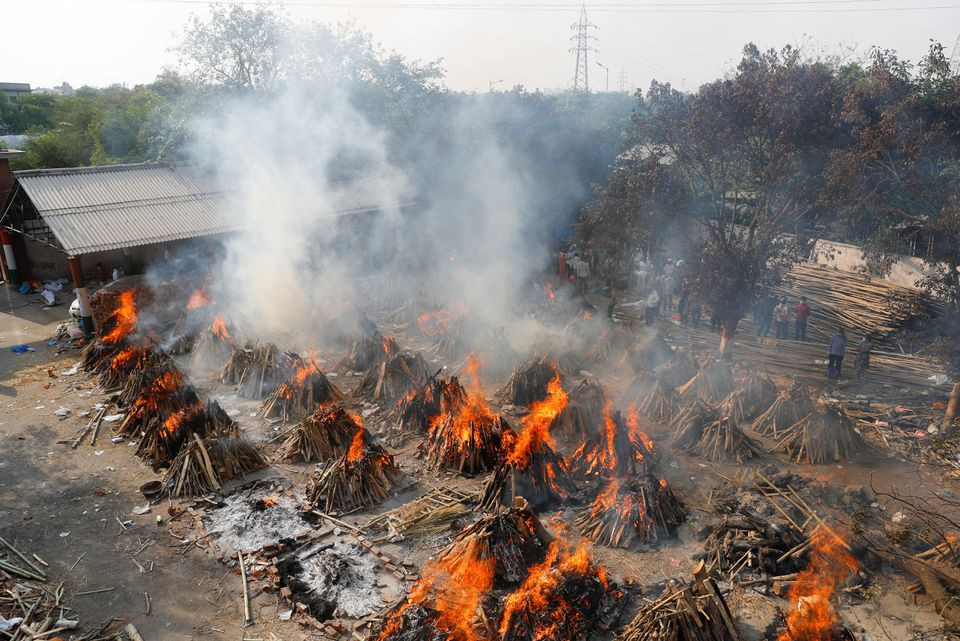 a general view of the mass cremation of those who died from the coronavirus disease covid 19 at a crematorium in new delhi india april 26 2021 reuters