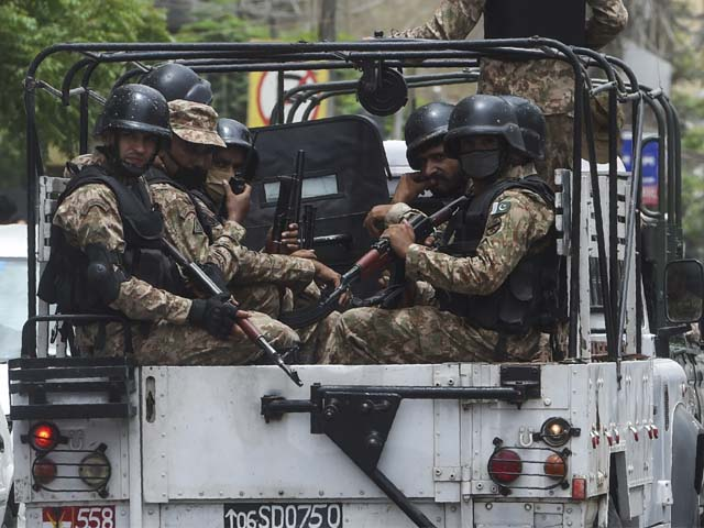 Paramilitary soldiers on patrol near the Pakistan Stock Exchange building following an attack. PHOTO: AFP