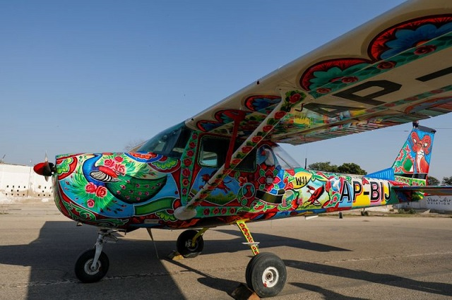 A two-seater Cessna aircraft painted with Pakistani truck art is seen at general aviation area at Jinnah International Airport in Karachi, Pakistan, December 30, 2020. PHOTO: REUTERS