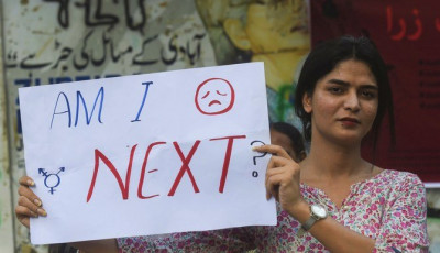 a-protestor-is-seen-holding-a-placard-in-karachi-during-a-protest-against-the-motorway-rape-photo-afp