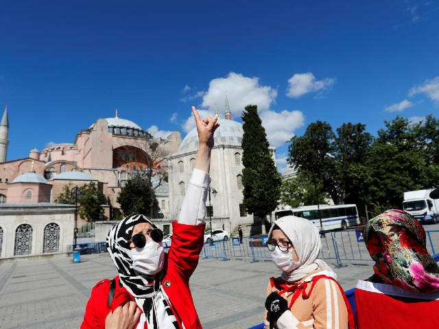 A woman gestures in front of the Hagia Sophia or Ayasofya, after a court decision that paves the way for it to be converted from a museum back into a mosque, in Istanbul, Turkey, July 10, 2020. PHOTO: REUTERS