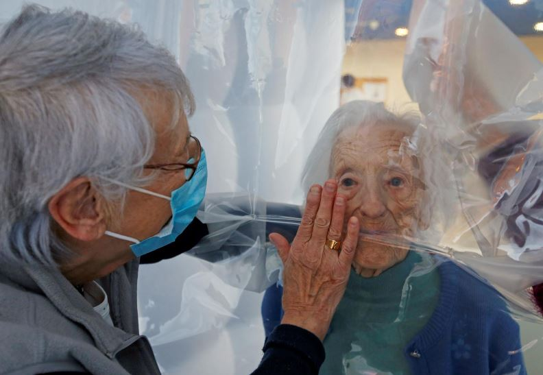 cuddling in covd hug bubble lets seniors feel the magic of touch