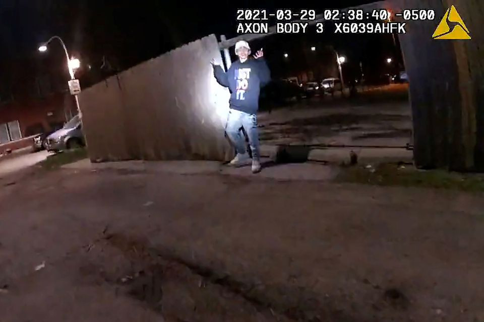 adam toledo 13 holds up his hands a split second before he was shot by police in little village a neighbourhood on the west side of chicago illinois us march 29 2021 in a still image from police body camera video image taken march 29 2021 photo reuters