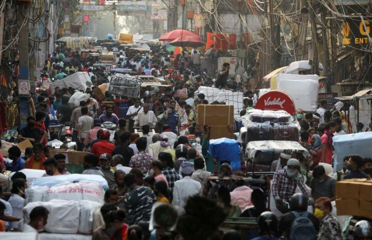 people walk at a crowded market amidst the spread of the coronavirus disease in the old quarters of delhi india photo reuters