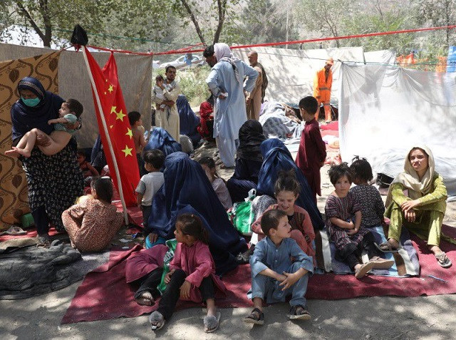 Internally displaced families from northern provinces, who fled from their homes due the fighting between Taliban and Afghan security forces, take shelter in a public park in Kabul, Afghanistan, August 10, 2021. PHOTO: REUTERS