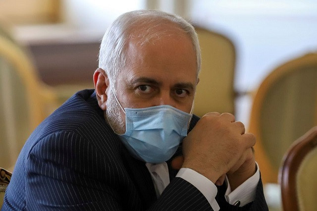 Iran's Foreign Minister Mohammad Javad Zarif looks on during a meeting with International Atomic Energy Agency (IAEA) Director General Rafael Grossi in Tehran, Iran February 21, 2021. PHOTO: REUTERS