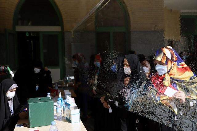 Iranians wait to vote at a polling station during presidential elections in Tehran, Iran June 18, 2021. PHOTO: REUTERS