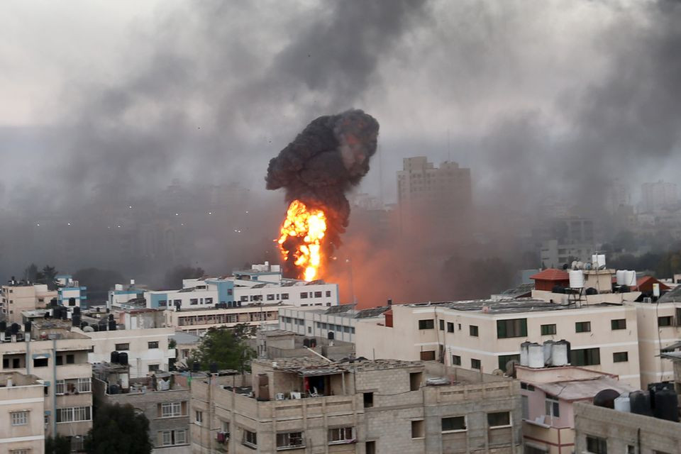 Smoke and flames rise during Israeli air strikes amid a flare-up of Israeli-Palestinian violence, in Gaza May 12, 2021. PHOTO: REUTERS