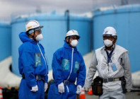 workers-are-seen-in-front-of-storage-tanks-for-radioactive-water-at-tokyo-electric-power-co-s-tepco-tsunami-crippled-fukushima-daiichi-nuclear-power-plant-in-okuma-town-fukushima-prefecture-japan-february-18-2019-photo-reuters