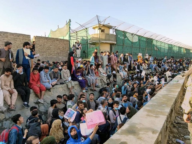 Crowds of people wait outside the airport in Kabul, Afghanistan August 25, 2021 in this picture obtained from social media. PHOTO: REUTERS