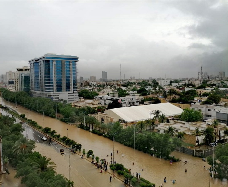 a view of a flooded two way thoroughfare in karachi following a monsoon rain spell photo express