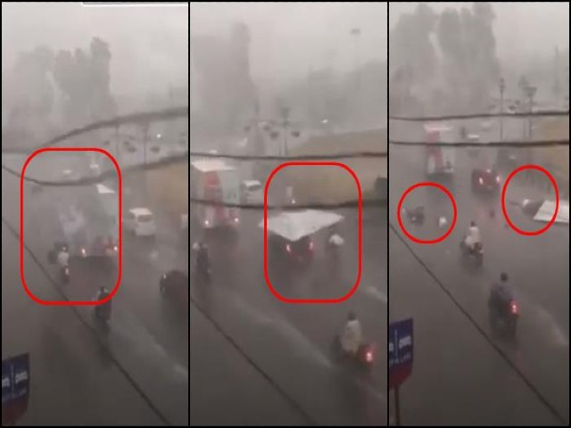 two motorcyclists were injured when a large billboard came loose and collapsed on them near metropole hotel photo twitter