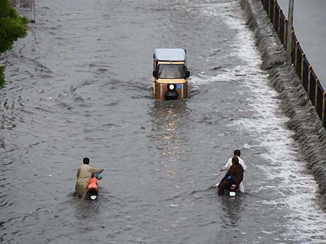 a view of a flooded road after heavy monsoon rains in karachi photo afp file
