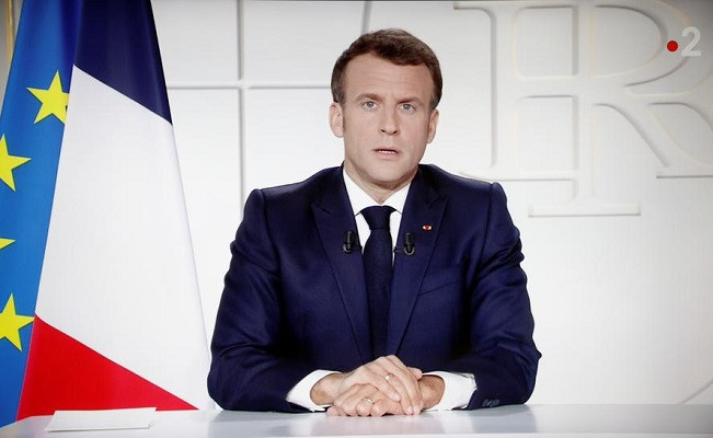 french president emmanuel macron is seen on a screen as he addresses the nation about the state of the coronavirus disease covid 19 outbreak as a fast spreading third wave of covid 19 infections threatens to over run hospitals in france march 31 2021 photo reuters
