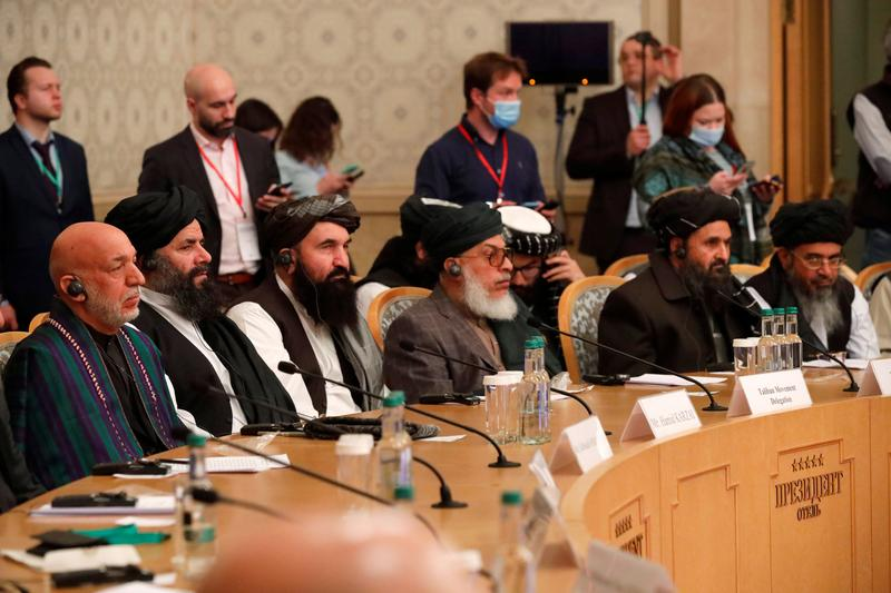 officials including afghan former president hamid karzai and the taliban s deputy leader and negotiator mullah abdul ghani baradar attend the afghan peace conference in moscow russia march 18 2021 photo reuters