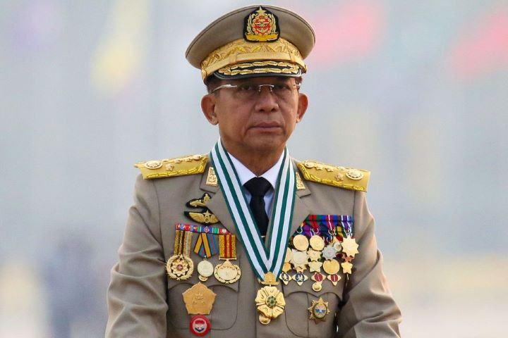 myanmar s junta chief senior general min aung hlaing who ousted the elected government in a coup on february 1 presides an army parade on armed forces day in naypyitaw myanmar march 27 2021 reuters stringer