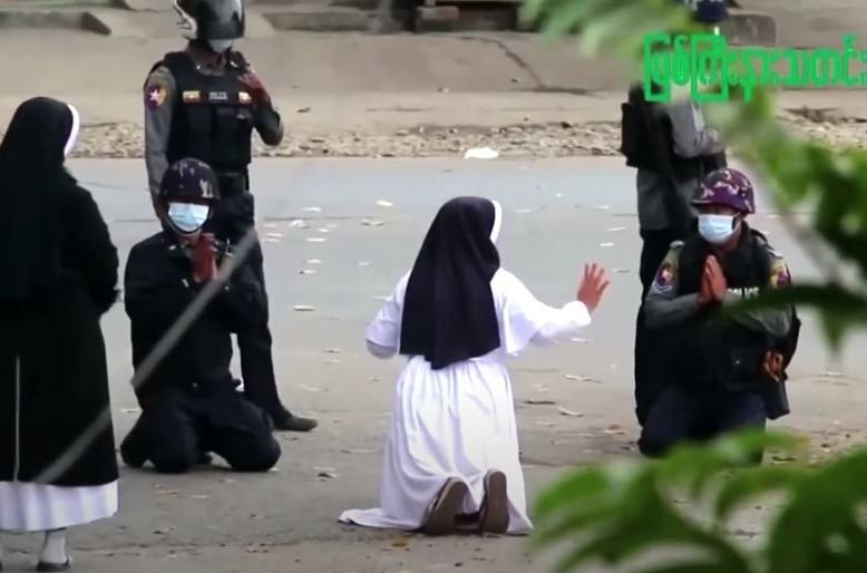 a myanmar nun sister ann rose nu tawng kneeled before police officers in the city of myitkyina to ask security forces to refrain from violence against children and residents screengrab reuters