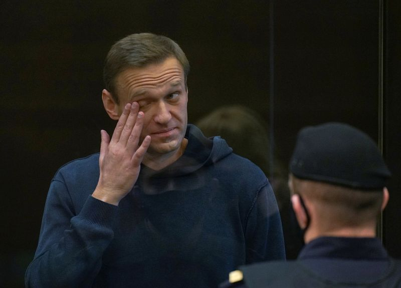 Russian court rejects Navalny's appeal but shortens jail term marginally
