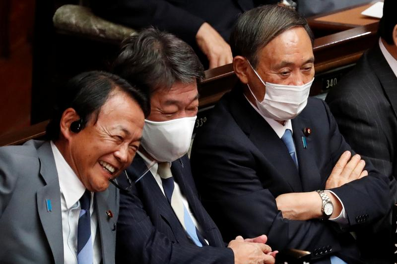 japan s finance minister and deputy prime minister taro aso foreign minister toshimitsu motegi and chief cabinet secretary yoshihide suga attend a parliamentary session at the lower house of the parliament in tokyo japan september 16 2020 photo reuters