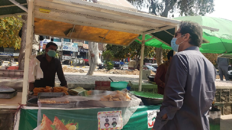 prime minister imran khan interacting with street vendor in islamabad photo pm office