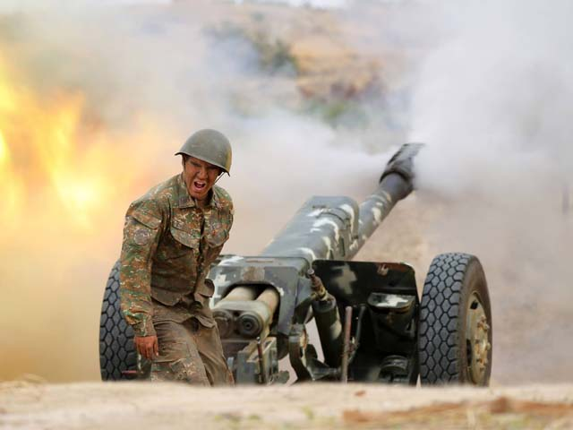 an armenian soldier fires an artillery piece during fighting with azerbaijan s forces photo reuters