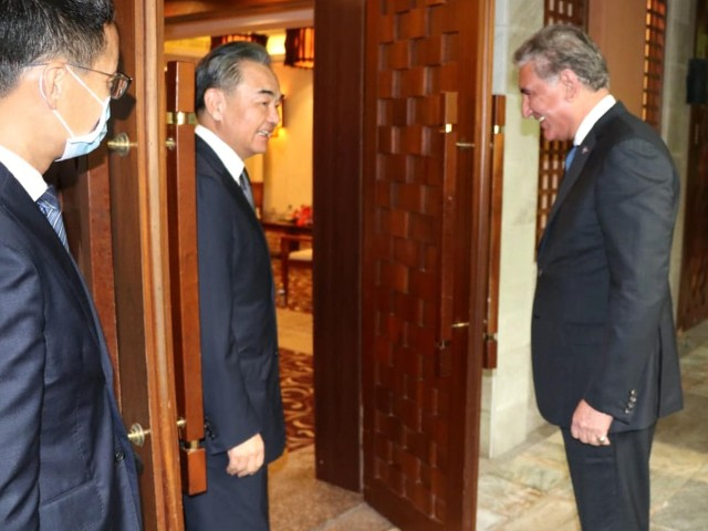 chinese state councillor and foreign minister shah wang yi receives foreign minister shah mehmood qureshi at hainan province in china on august 21 2020 photo pid
