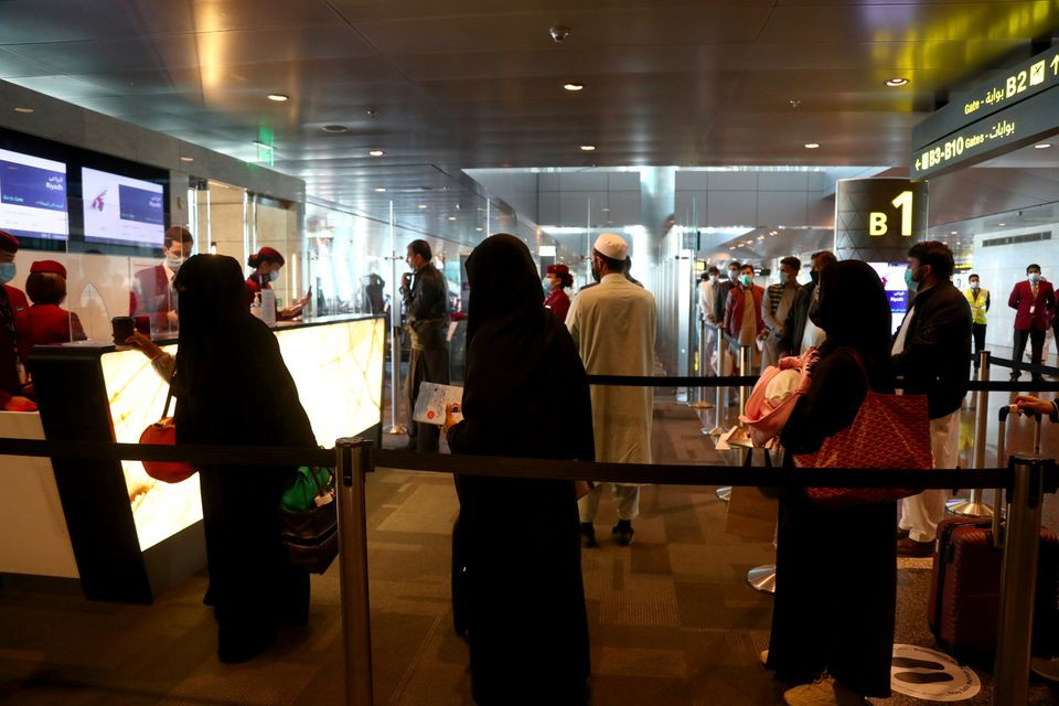 passengers queue to check in at hamad international airport as the country resumes international flights to saudi arabia in doha qatar january 11 2021 photo reuters file