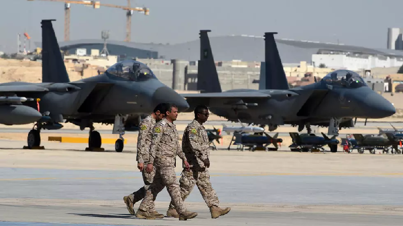 saudi military officers walk past f 15 fighter jets gbu bombs and missiles displayed during a ceremony marking the 50th anniversary of the creation of the king faisal air academy at king salman airbase in riyadh in 2017 photo afp