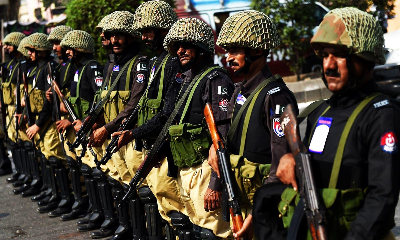policemen patrol during a procession in karachi photo afp