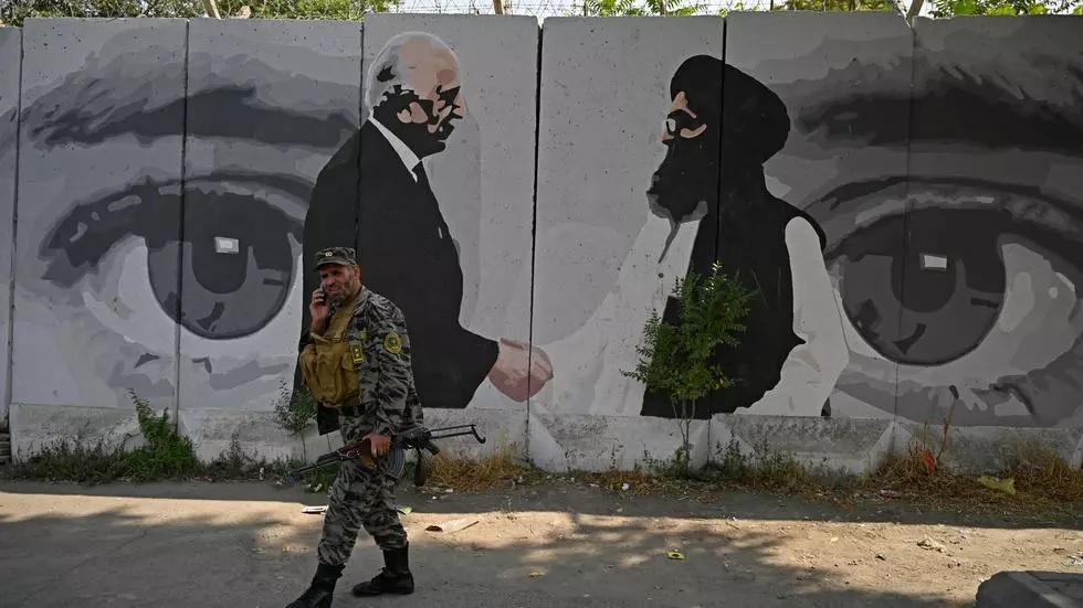 taliban say team in qatar for afghan peace talks