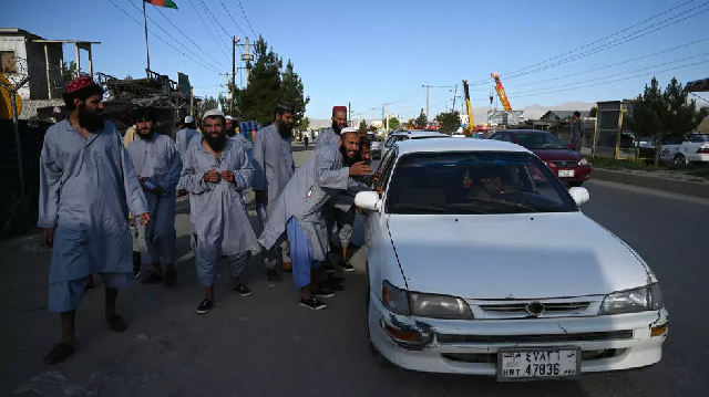 taliban accuse kabul of re arresting freed insurgents