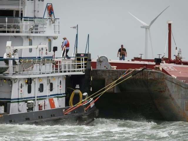 men work atop a vessel in the corpus christi ship channel on march 11 2019 the texas city is bracing for the first atlantic hurricane of 2020 hanna to make landfall on saturday photo afp