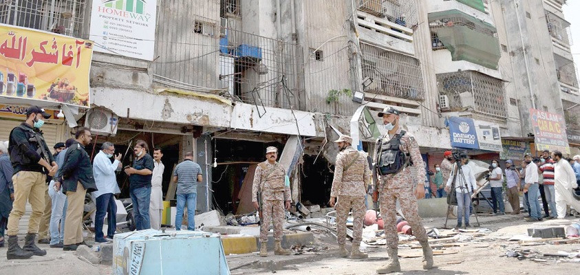 law enforcement personnel cordoned off the blast site and initiated investigations on wednesday the blast which ripped through a pizza outlet located in a residential building left the eatery and two realtors offices devastated photo app