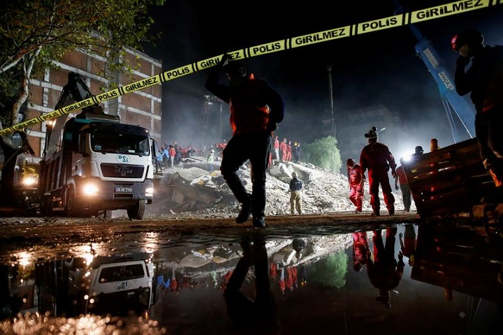 rescue operations take place on a site secured by the police after an earthquake struck the aegean sea in the coastal province of izmir turkey november 1 2020 photo reuters