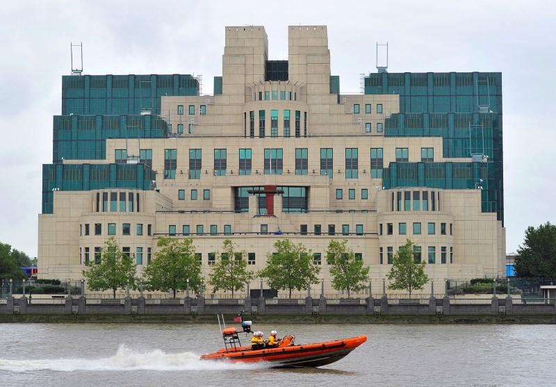 a motorboat passes by the mi6 building in london august 25 2010 photo reuters