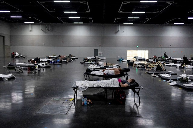 People sleep at a cooling shelter set up during an unprecedented heat wave in Portland, Oregon, June 27. PHOTO: REUTERS