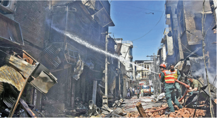 burnt to ashes the cooling process continues in the fire hit urdu bazaar as smoke rises from the shops gutted in the blaze