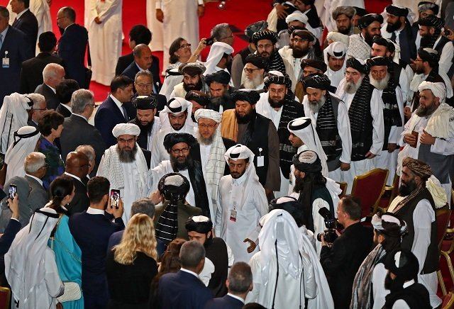 members of the taliban delegation arrive to the signing of a us taliban landmark agreement in the qatari capital doha on february 29 2020 photo afp file