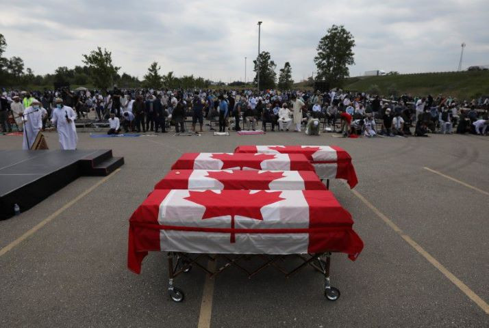 flag wrapped coffins are seen outside the islamic centre of southwest ontario during a funeral of the afzaal family that was killed in what police describe as a hate motivated attack in london ontario canada june 12 2021 reuters carlos osorio