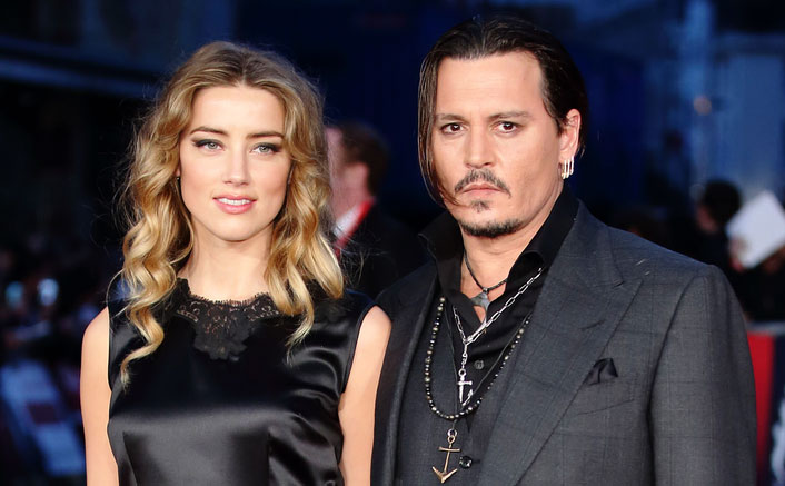 johnny depp claims amber heard punched him upon learning about his debt